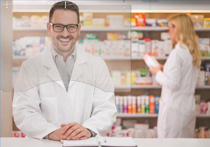 pharmacist behind hanging barrier